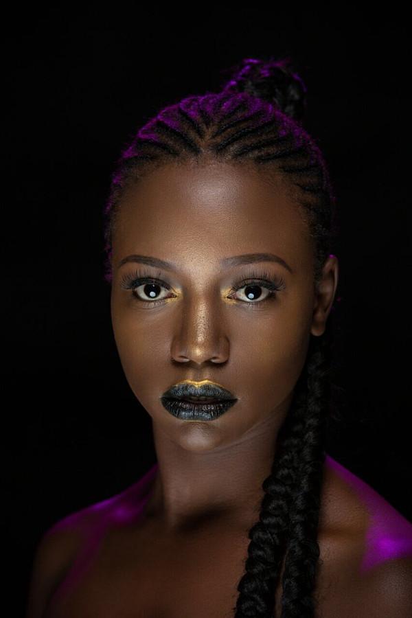 Abigael Yimbo model. Photoshoot of model Abigael Yimbo demonstrating Face Modeling.Face Modeling Photo #187739