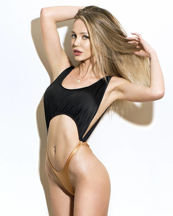 Alexander Karmios photographer & filmmaker. Work by photographer Alexander Karmios demonstrating Body Photography in a photo-session with the model Kirsten Ciel Lauder.model: Kirsten Ciel Lauderdesigner: giota vatitsiSwimwearBody Photography Photo