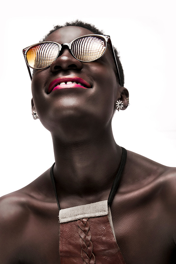 Alloys Iteba photographer. Work by photographer Alloys Iteba demonstrating Portrait Photography in a photo-session with the model Agoro Adhiambo.model: Agoro AdhiamboEarrings,EyewearPortrait Photography Photo #178333