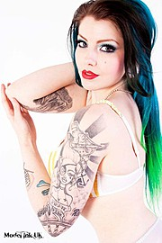Amie Conradine is a model and Musician. Her work experience includes being a covergirl for Bizarre & Skin Deep Magazine as well as other pub