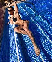 Cindy Landolt fitness model. Photoshoot of model Cindy Landolt demonstrating Body Modeling.Body Modeling Photo #174284