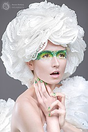 Ewa Paczkowska model & makeup artist. Ewa Paczkowska demonstrating Face Modeling, in a photoshoot by Marian Wodzisz.Photographer: Marian WodziszMUA: Dorota OzarowskaFace Modeling Photo #129205