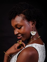 Grace Mugire model. Photoshoot of model Grace Mugire demonstrating Face Modeling.This photo was taken by a photographer by the name (Dan shutter). I was approached by a natural hair company (Sheth Naturals) to help promote a campaign (#Dauntless ca