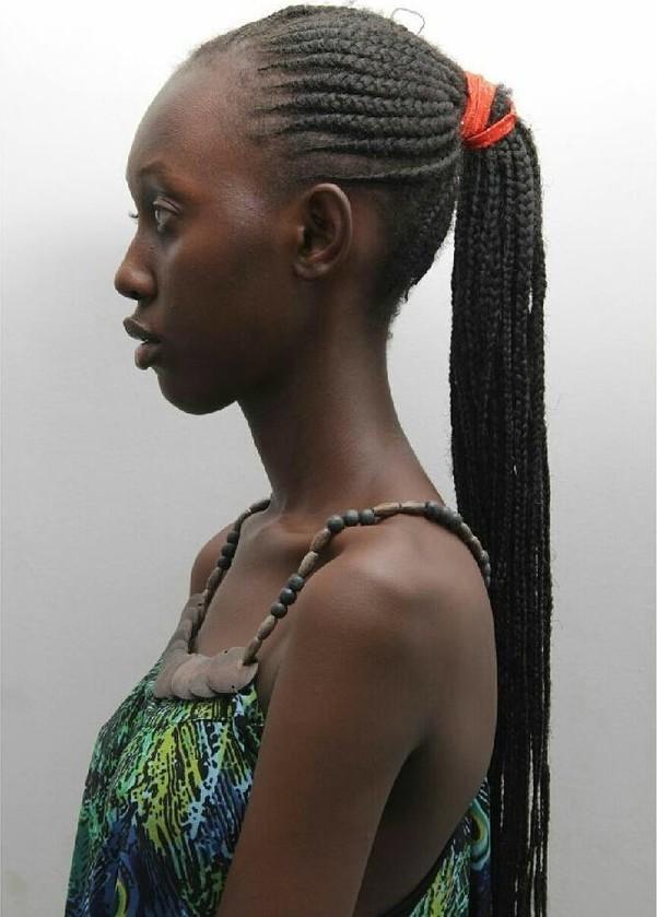 Lilian Mmbando model. Photoshoot of model Lilian Mmbando demonstrating Face Modeling.Face Modeling Photo #186742