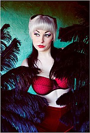 Lilith is an internationally published Pin Up & Alternative model - Burlesque/Performance artist.  With 4 plus years worth of experience and