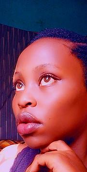 Lucy Maina model. Photoshoot of model Lucy Maina demonstrating Face Modeling.Lucy Maina - Make up artistBrian Kariuki - Professional Hair StylistFace Modeling Photo #226323