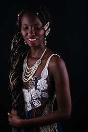 Maureen Nduta model. Maureen Nduta demonstrating Fashion Modeling, in a photoshoot by Maingi Kuria.Braids,NecklaceFashion Modeling Photo #171265