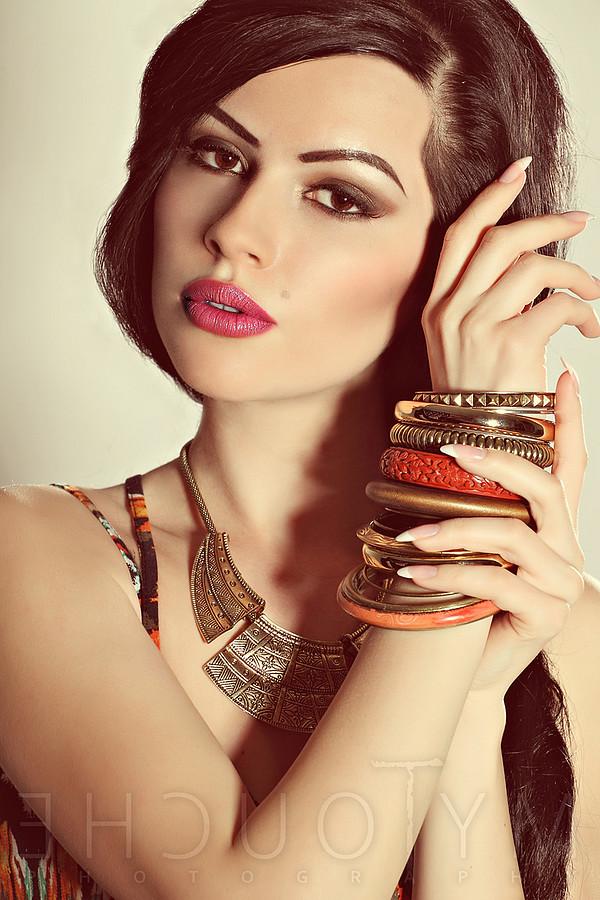 Mihaela Manole model. Photoshoot of model Mihaela Manole demonstrating Face Modeling.Necklace,BraceletFace Modeling Photo #94794