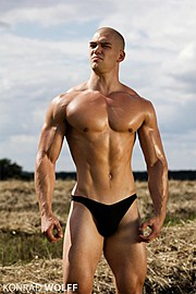Mischa Janiec natural bodybuilder. Mischa Janiec demonstrating Body Modeling, in a photoshoot by Konrad Wolff.photographer Konrad WolffBody Modeling Photo #73680
