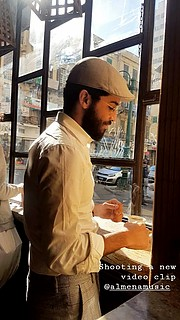 Omar Abdou model. Photoshoot of model Omar Abdou demonstrating Commercial Modeling.Video-shoot in Brazilian Coffee located in the center of Alexandria, Egypt. The photo was taken by Elaria Naeem for the video clip of the Egyptian music band - Almen
