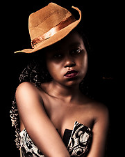 Roy Mungez photographer. Work by photographer Roy Mungez demonstrating Portrait Photography in a photo-session with the model Diana Muli.Model: Diana MuliHat: Credible Hats@manyattafilmsPortrait Photography Photo #210751